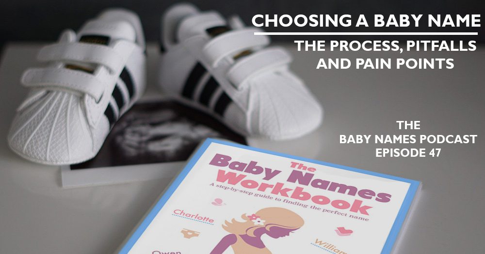 Baby Names Workbook next to an ultrasound and baby shoes