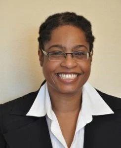 Headshot of Dr. Iman Nick smiling